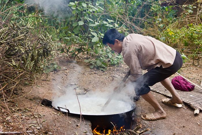 Man making rice whiskey at minority village in Mai Chau in Vietnam.