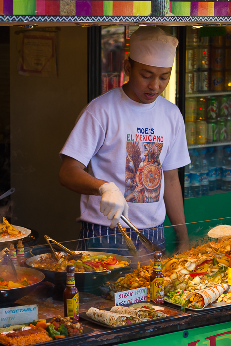 Man preparing Mexican food at a food stall in Camden Market.