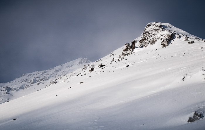 Awinter photography shot of a snow covered mountain.