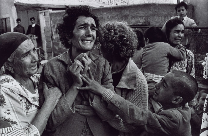Gripping war photography portrait of grieving people by Don McCullin, famous photographers and their work.