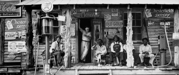 Dorothea Lange famous photo of men outside a shop front during the Great Depression era