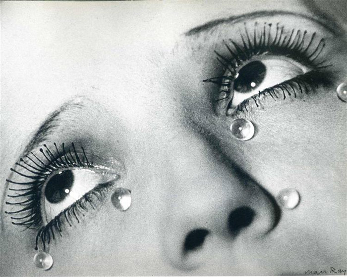 Man Ray close up of a womans eyes with round teardrops on her face - famous photographers