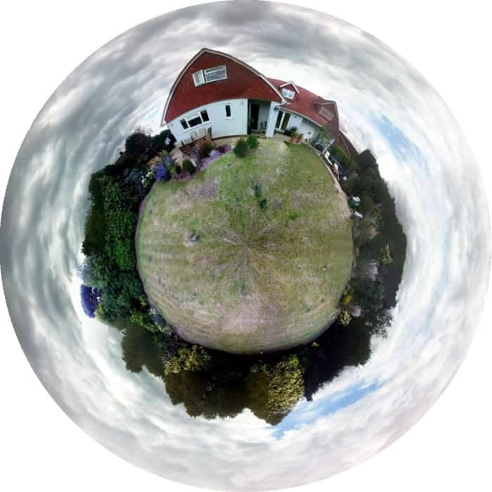 A mini globe panorama of a house and garden compact in a circular shape