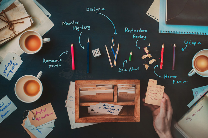 Overhead still life of coffee cups, pencils and writing equipment