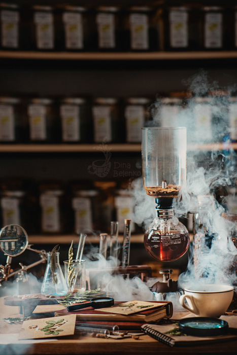 A still life of coffee brewing equipment on a wooden desk, in the style of a scientists workshop