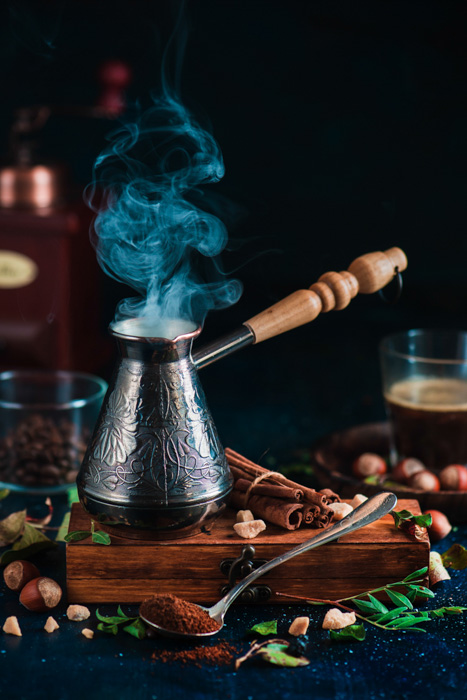 Magical coffee photography brewing equipment shot on dark background