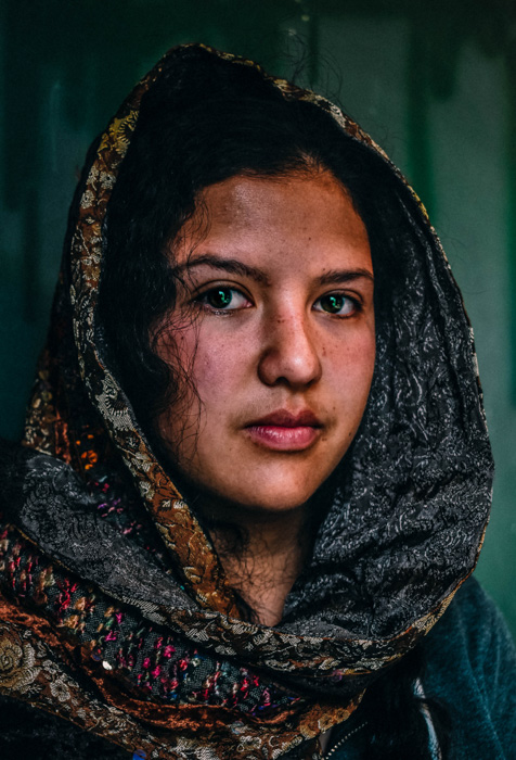 Stunning environmental portrait of a girl in a headscarf