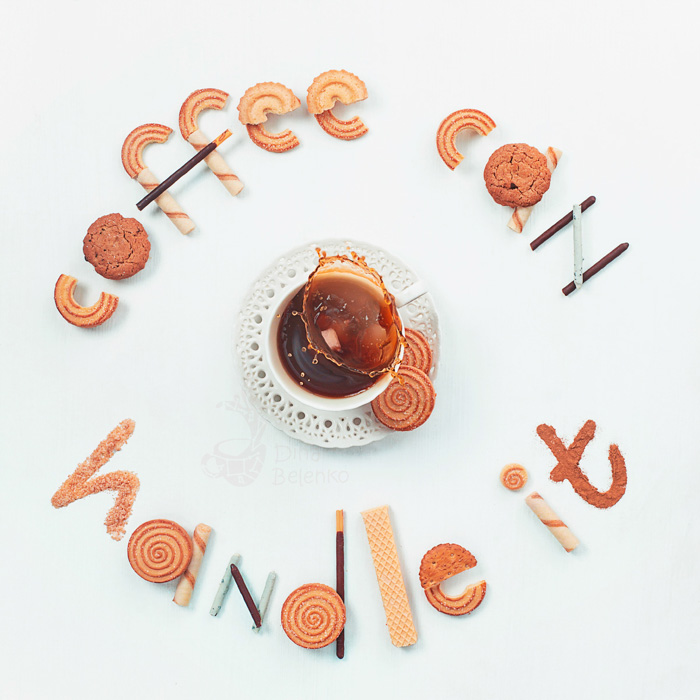 An overhead food art shot featuring coffee cups, saucers, biscuits with food typography message 'coffee can handle it'.