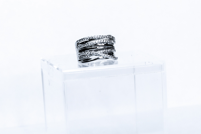 A close up of a silver ring on a display box