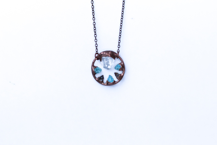 A jewelry photography close up of a pretty necklace on white background