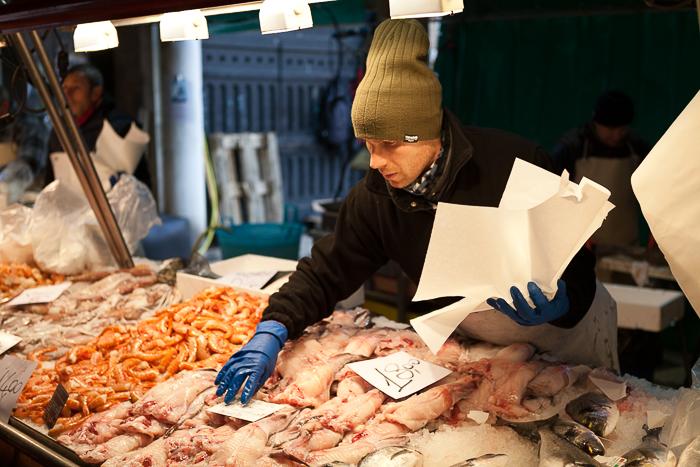 An environmental portrait of a market vendor at a meat market