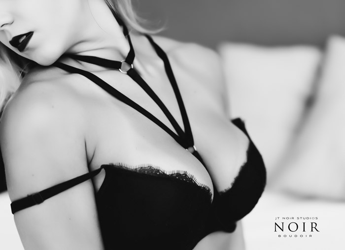 Black and white boudoir photography of a girl in black lingerie - what to bring for a boudoir shoot
