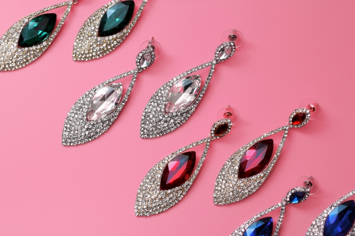 Diamond earrings on a pink background