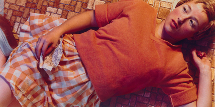 A Cindy Sherman photograph of a female model lying on the floor
