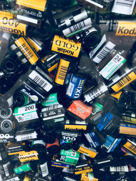 An overhead view of many rolls of film including Kodak, Fuji and lomography