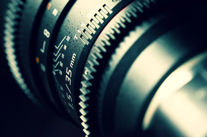A close up shot of a 35mm camera lens, food photography tips