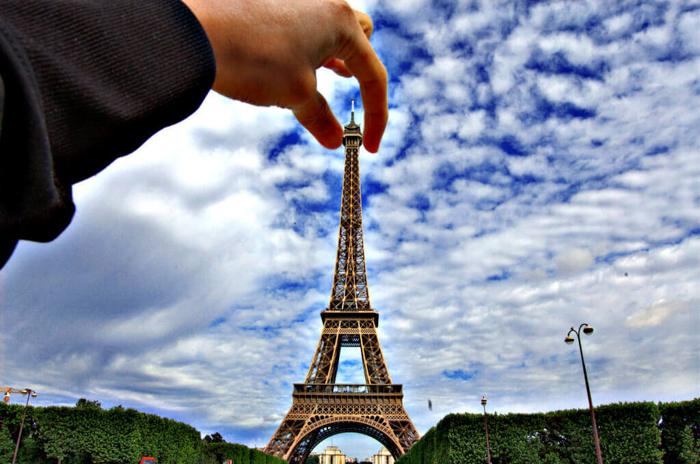 Classic forced perspective idea of a person 'holding' the Eiffel tower