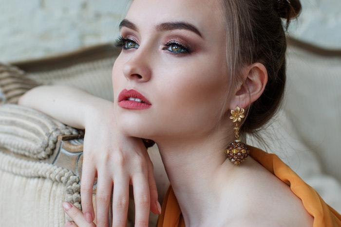 A girl modelling gold earrings