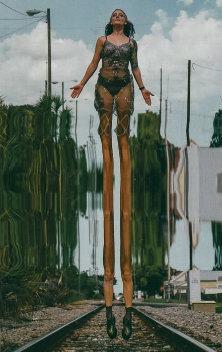 A woman posing with the appearance of having freakishly long legs due to image glitch