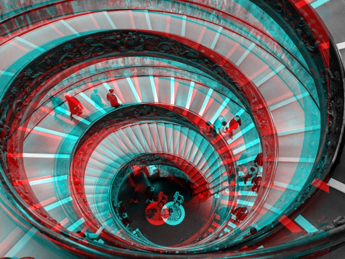 A spiral staircase edited with a glitch art effect