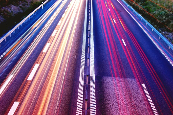 colored light trail from cars on a busy motorway