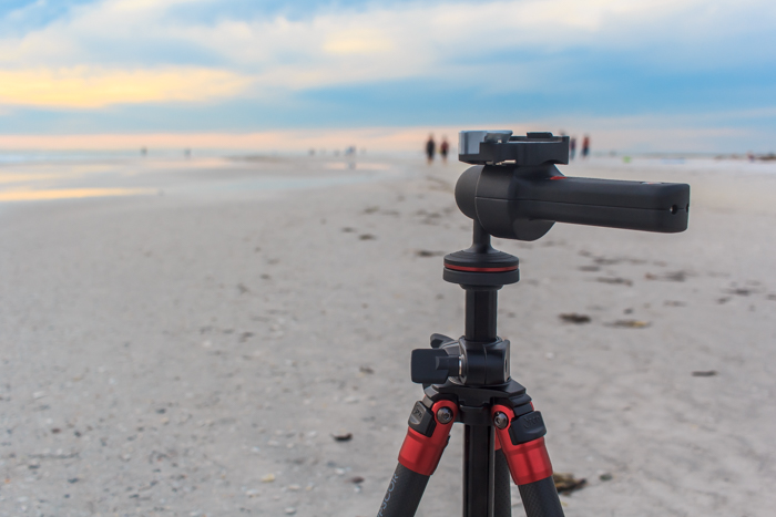 A tripod set up on a beach for landscape nature photography