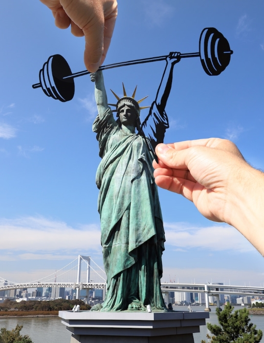 Creative forced perspective example using the statue of Liberty