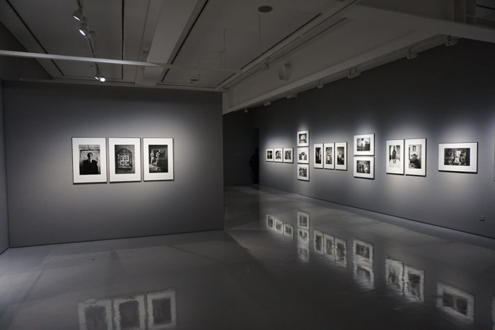 a gallery with a photography exhibition