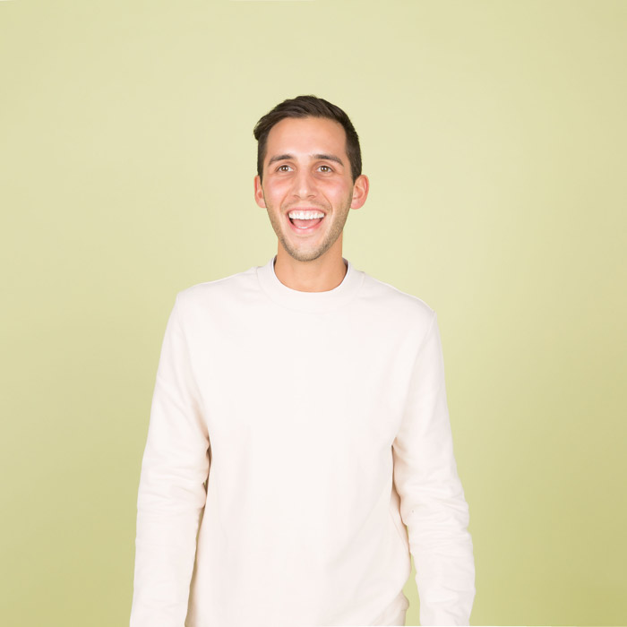 a playful of a young man in white shirt against a yellow background - photography lighting facts