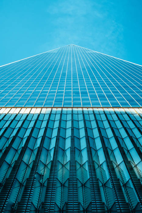 An architectural shot of a multi windowed glass building shot from an interesting perspective