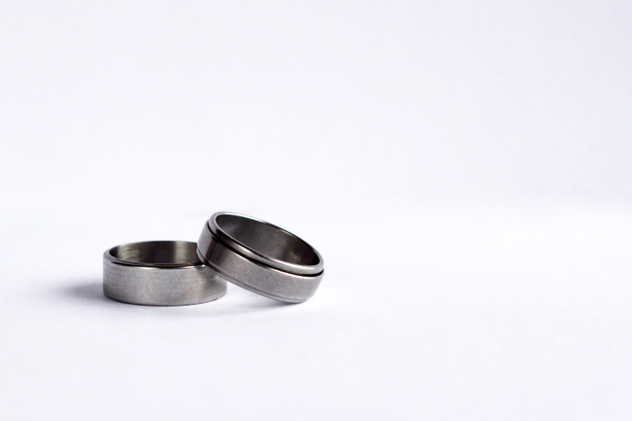 Two silver rings on a white background