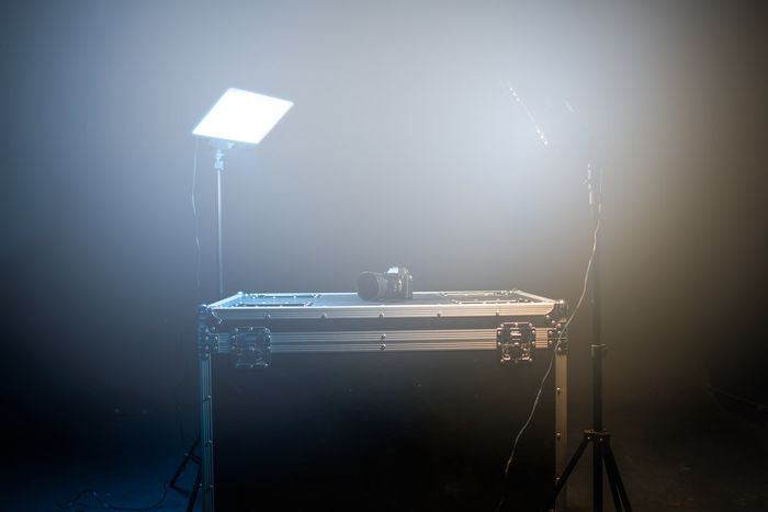 Photo of a minimal studio with a table and lighting