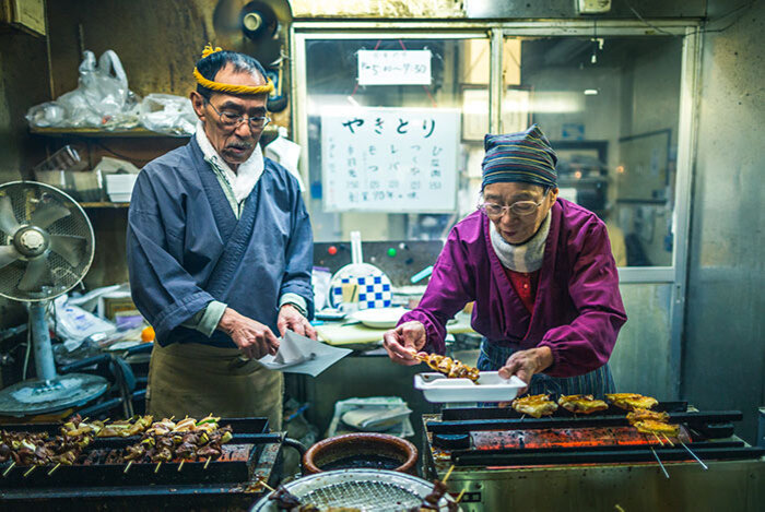 Photo of people at an Asian market food stall