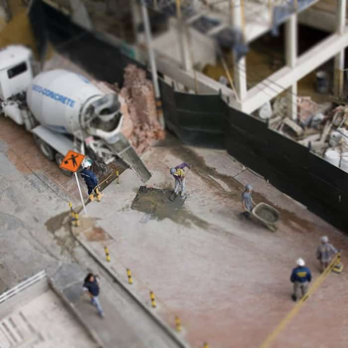 Overhead shot of a construction site with men working using tilt-shift photography