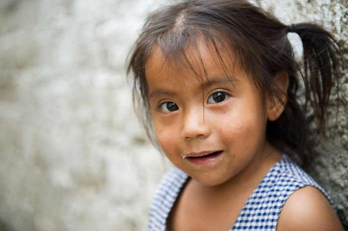 A close up portrait of a little girl taken by a travel photographer