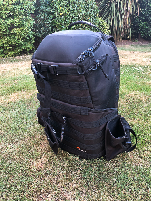 A large backpack for travel photography on the grass