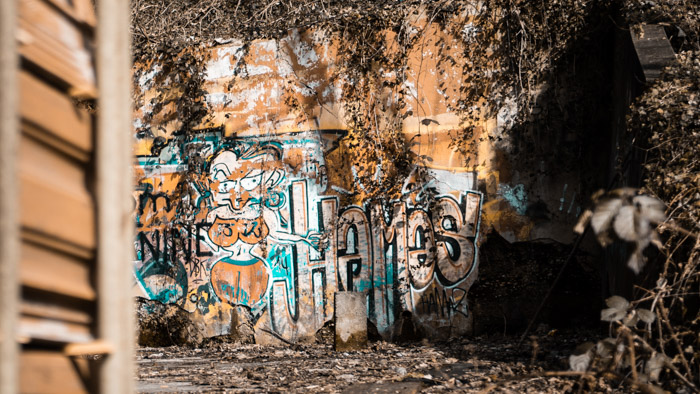 A wall with graffiti found during an urban exploration trip