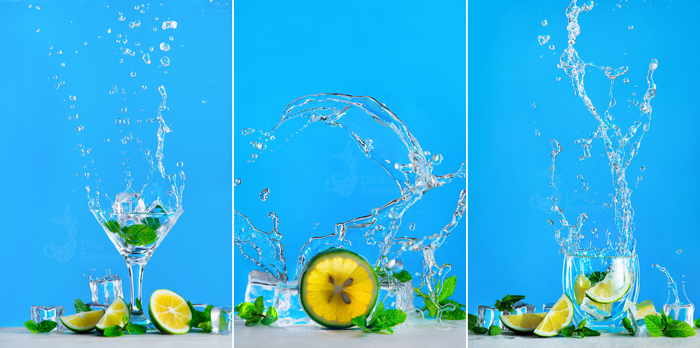 Dynamic water splash with a glass of mojito or lemonade on a bright blue background. Refreshing summer drink concept with copy space.
