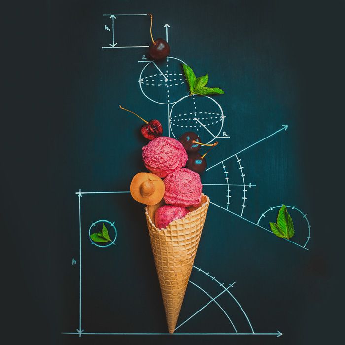 A creative still life with an ice-cream cone on a chalkboard surface