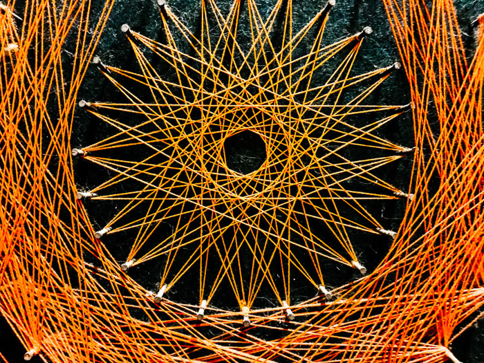 A close up of a pattern made with orange twine - smartphone abstract photography tips