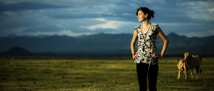 Atmospheric shot of a girl standing in a countryside area