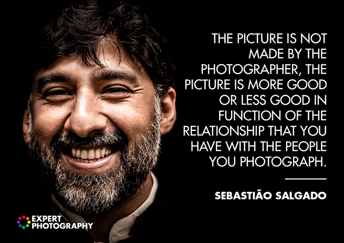 A close up portrait of a smiling bearded man on dark background overlayed with a quote from Sebastiao Salgado - good photography quotes from famous photographers