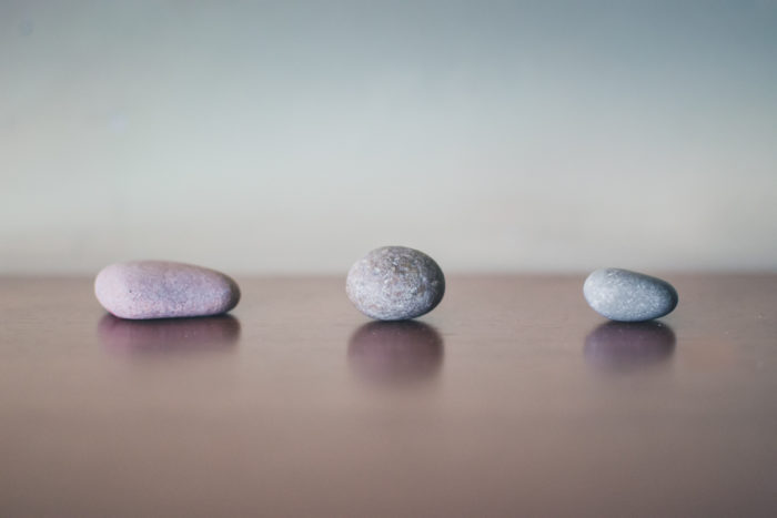 photo of three stones placed in a line