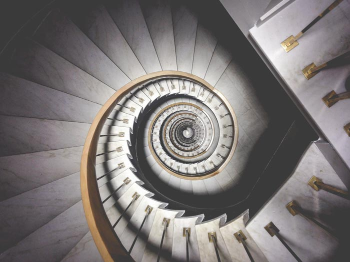 A photo looking down an elaborate spiral staircase