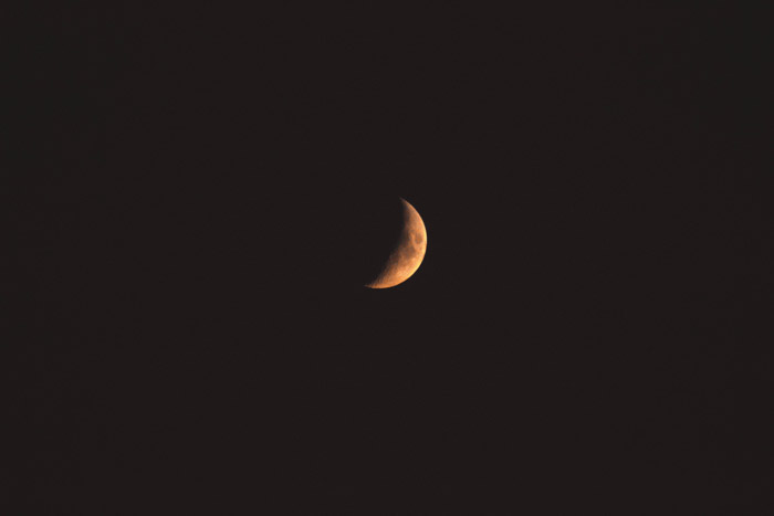 Close up photo of a crescent moon - astrophotography filter
