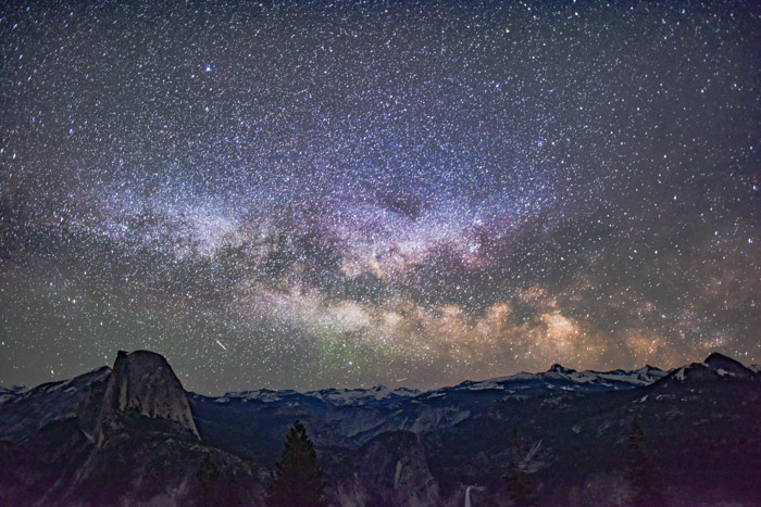 magnificent shot of the night sky littered with starts above a beautiful mountainous landscape