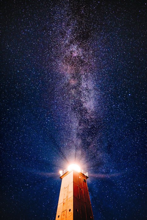 magnificent shot of the night sky littered with starts above a tower - astrophotography filters