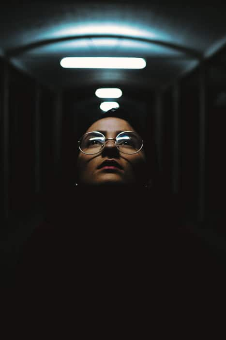 Atmospheric portrait of a girl in a dark tunnel