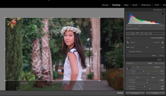 using grid in lightroom to crop a photo of a woman in a white dress wearing a flower crown
