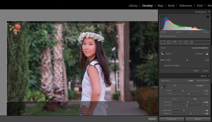 using the golden ratio while cropping a photo of a woman in a white dress wearing a flower crown in lightroom